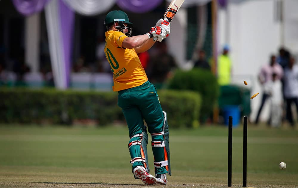 South African batsman David Miller is bowled while playing against India A during a practice Twenty20 match in New Delhi.