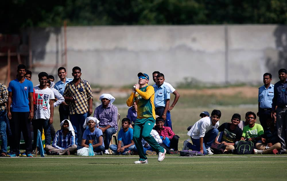 People watch as South Africa's David Miller takes a catch during a practice Twenty20 match against India A team in New Delhi.