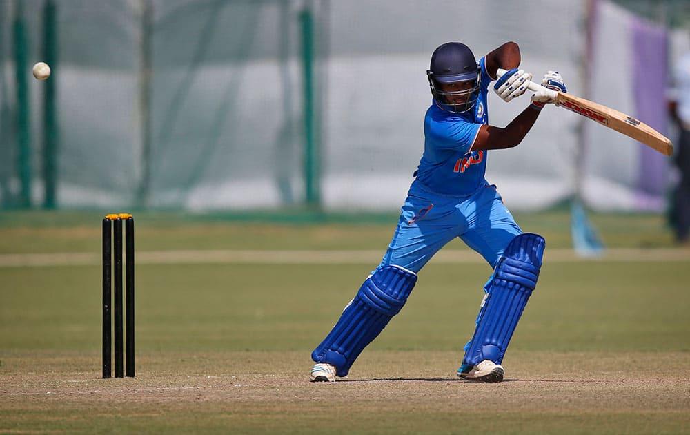 India A's batsman Sanju Samson hits a ball against South Africa during a practice Twenty20 match in New Delhi.