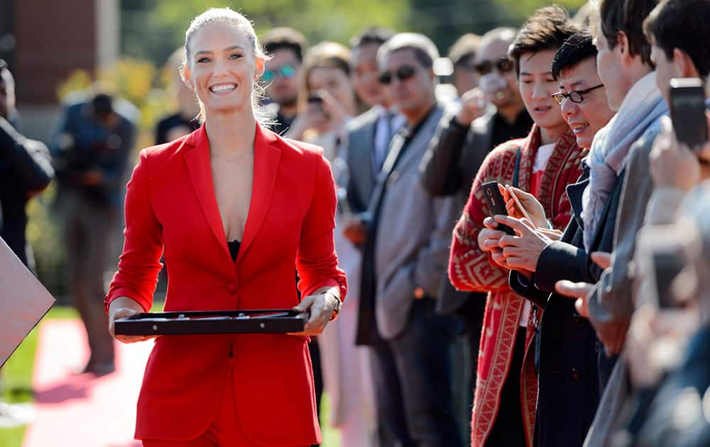 Israeli model Bar Refaeli brings the scissors for the ribbon cutting ceremony during the inauguration ceremony of an extension of the manufacture of the Swiss luxury watchmaker Hublot, owned subsidiary of France's LVMH, in Nyon, Switzerland.