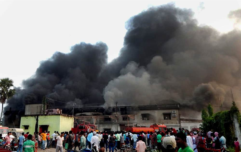 Smoke billowing out of a medicine factory after a fire at Rajarhat in North 24 Pargana district of West Bengal.