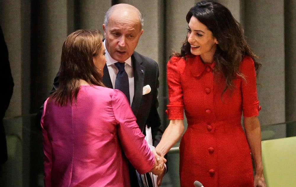 Amal Clooney, greets Mexicos FM Claudia Ruiz Massieu and Frances FM Laurent Fabius before a meet 'Framing the veto in event of mass atrocities' at UN HQ.