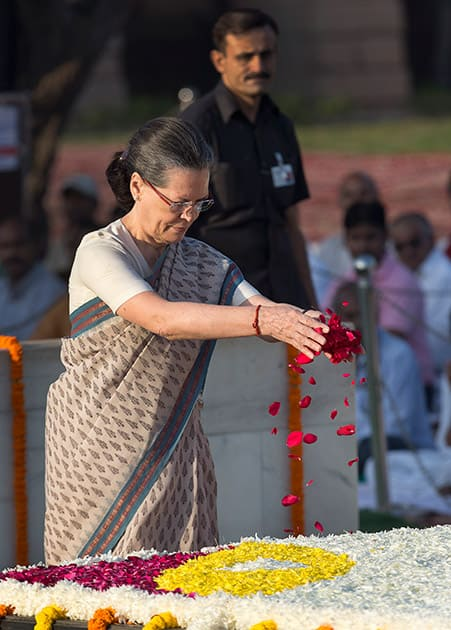 Congress party President Sonia Gandhi offers floral tributes at the memorial of Mahatma Gandhi on the occasion of his birth anniversary, in New Delhi.