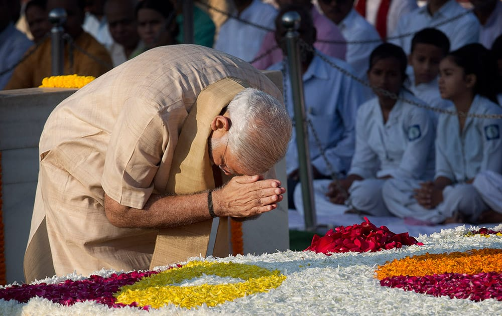 Prime Minister Narendra Modi pays tributes at the memorial of Mahatma Gandhi on the occasion of his birth anniversary, in New Delhi.