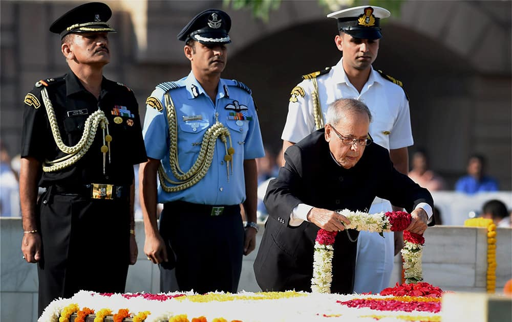President Pranab Mukherjee pays tributes at Rajghat, the memorial of Mahatma Gandhi on the occasion of his birth anniversary, in New Delhi.