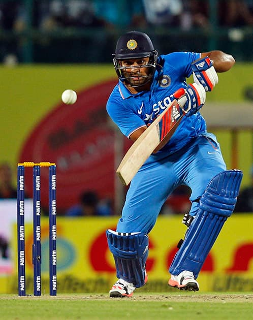 Rohit Sharma bats during the first Twenty20 cricket match against South Africa in Dharmsala.
