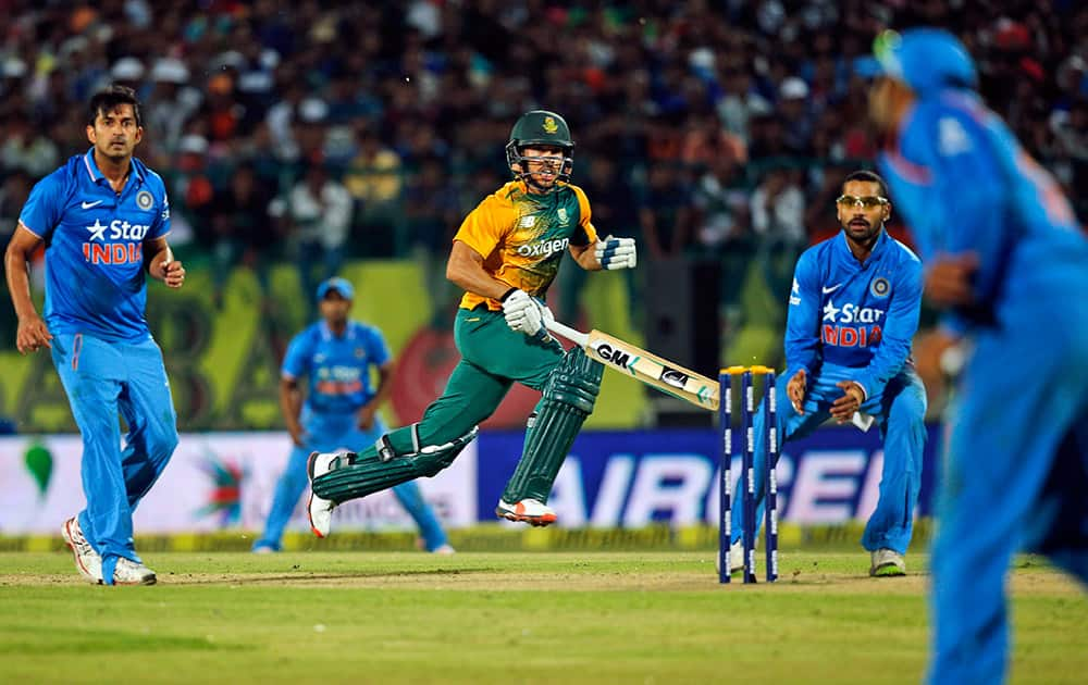 South Africa's Farhaan Behardien takes a run during the first Twenty20 cricket match against India in Dharmsala.