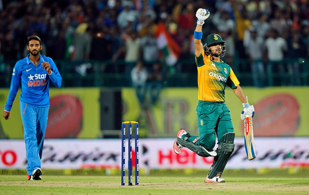 South Africa's Jean-Paul Duminy raises his hand as he completes the winning run during the first Twenty20 match against India in Dharmsala.