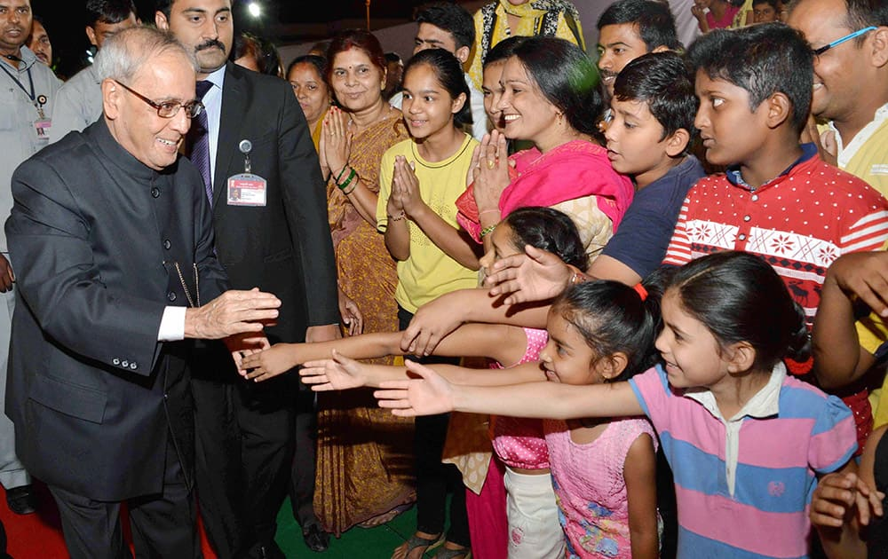 President Pranab Mukherjee meeting children at the inauguration of a Food Festival on the occasion of Gandhi Jayanti at President's Estate in New Delhi.