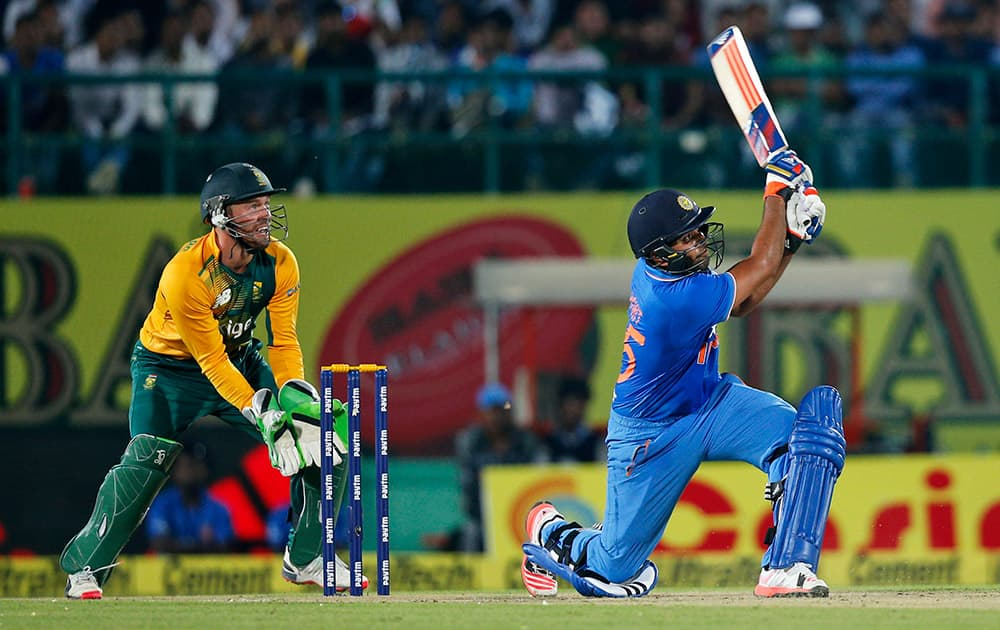 ROHIT SHARMA HITS A SIX DURING THE FIRST TWENTY20 CRICKET MATCH AGAINST SOUTH AFRICA IN DHARMSALA.