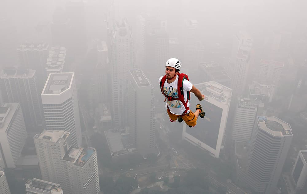 BASE jumper Mael-Baguet of France dives in the air from the Kuala Lumpur Tower during the KL Tower International Jump in Kuala Lumpur, Malaysia.