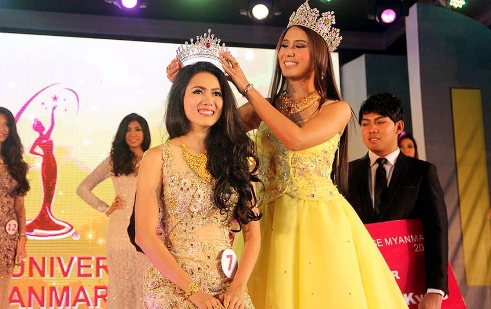 May Barani Thaw, winner of Miss Universe Myanmar 2015 receives her crown from Shar Htut Eaindra, winner of Miss Universe Myanmar 2014, during the Miss Universe Myanmar competition in Yangon, Myanmar.