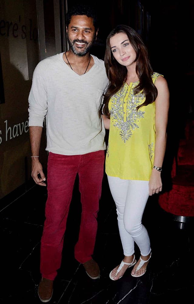 Amy Jackson with Director Prabhudheva during promotion of their film Singh Is Bling in Mumbai.