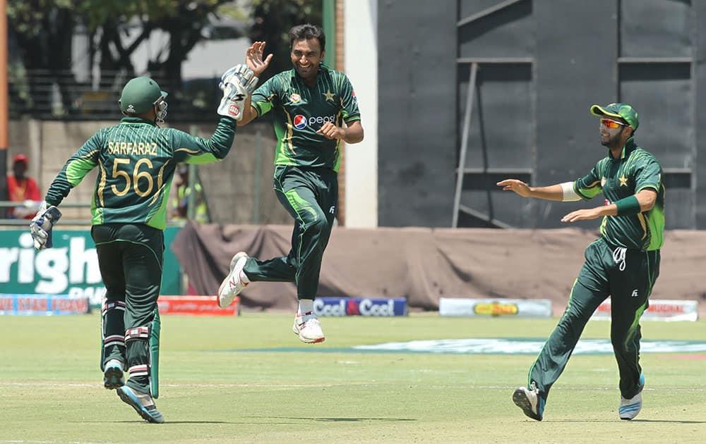 Pakistan bowler Bilal Asif celebrates the wicket of Zimbabwean batsman Brian Chari during the One Day International Cricket match between Zimbabwe and Pakistan in Harare.