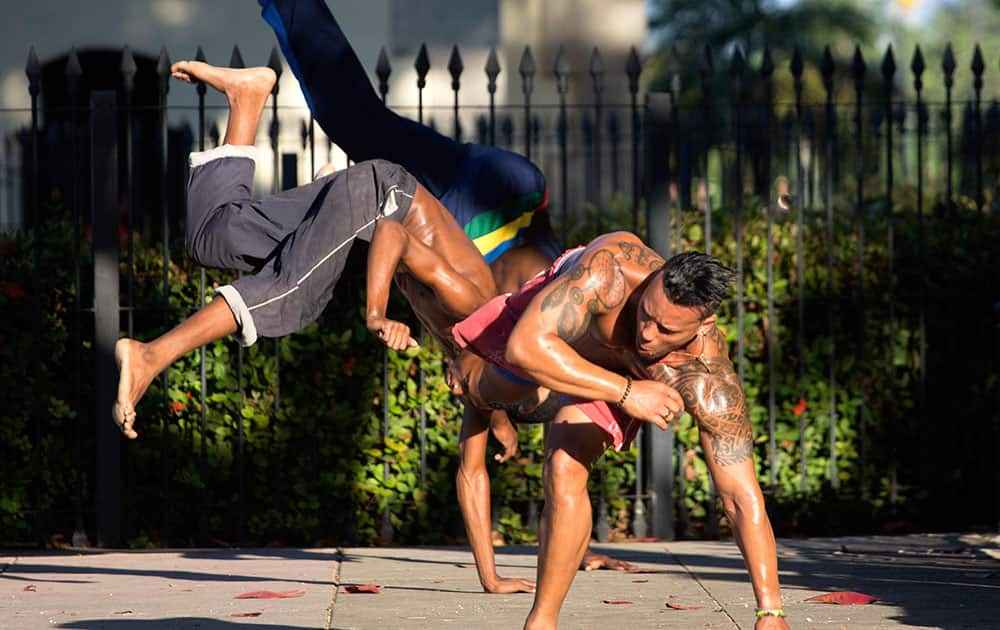 Youths attend a Capoeira lesson on a street in Havana, Cuba.