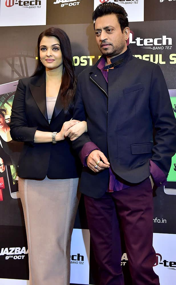 Bollywood actress Aishwarya Rai Bachchan (L) with actor Irrfan Khan during promotion of their upcoming film Jazbaa in New Delhi.