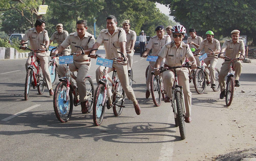 Police officials riding bicycles to create awareness for car free day in Gurgaon.