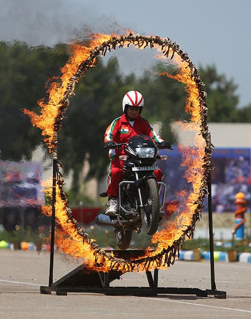 A Rapid Action Force woman soldier displays her skills during their 23rd anniversary celebrations on the outskirts of Hyderabad