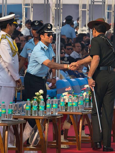 Former Indian cricketer and honorary Indian Air Force (IAF) officer Sachin Tendulkar shakes hand with Indian army chief Dalbir Singh Suhag during the Air Force Day parade at Hindon Air Force base near New Delhi.