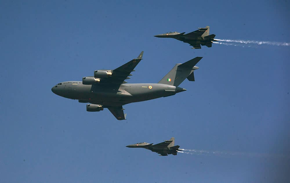 Indian Air Force C-17 Globemaster, center, flies with two Sukhoi Su-30 MKI during the Air Force Day parade at Hindon Air Force base near New Delhi.