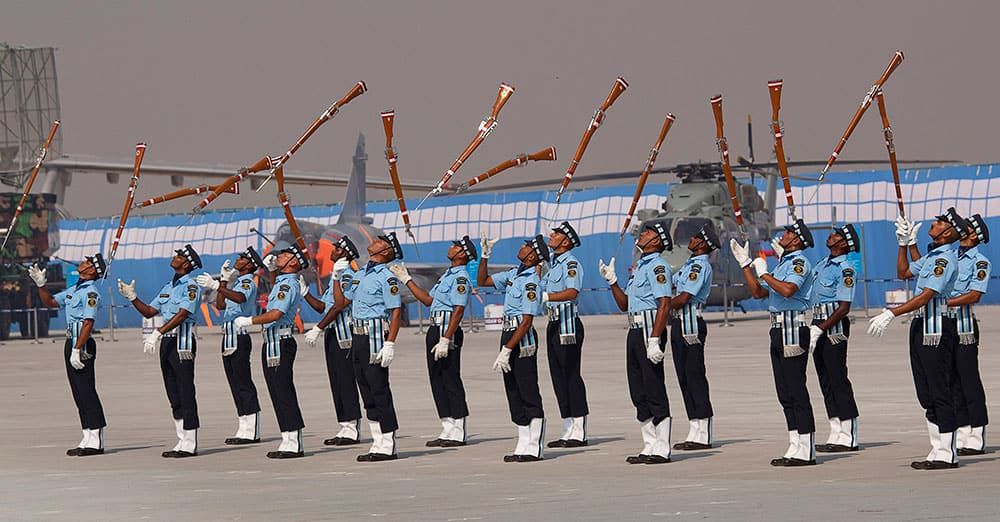 Indian Air Force Air Warrior Drill team display their skills during the Air Force Day parade at Hindon Air Force base near New Delhi.