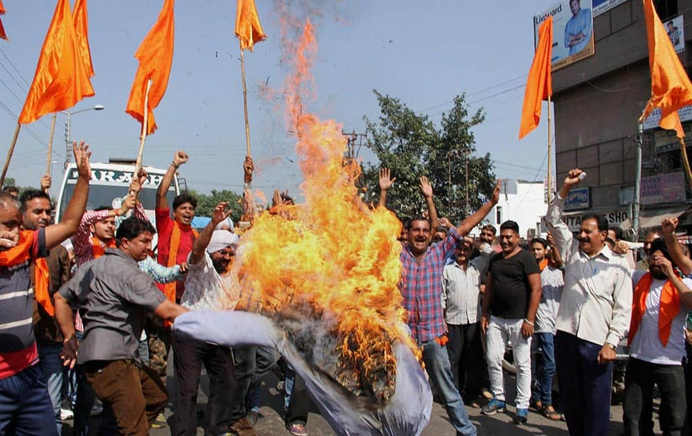 Activists of Hindu Shiv Sena burn an effigy of the independent MLA Er Abul Rasheed for organizing a beef party in Jammu.