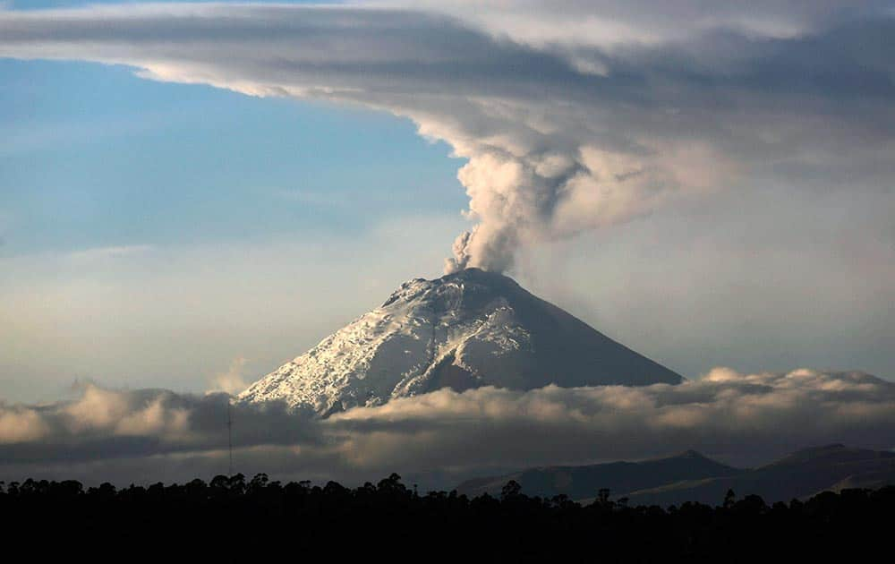 A large plume of ash and steam rises from the Cotopaxi volcano as seen from Quito, Ecuador.