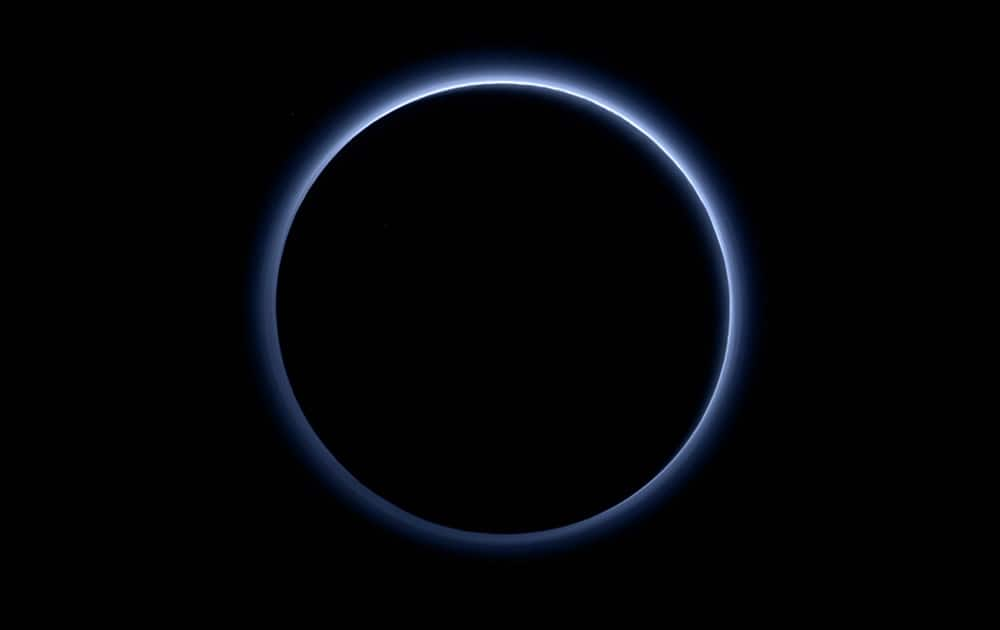 This image released by NASA, shows the blue color of Pluto's haze layer in this picture taken by the New Horizons spacecrafts Ralph/Multispectral Visible Imaging Camera (MVIC).