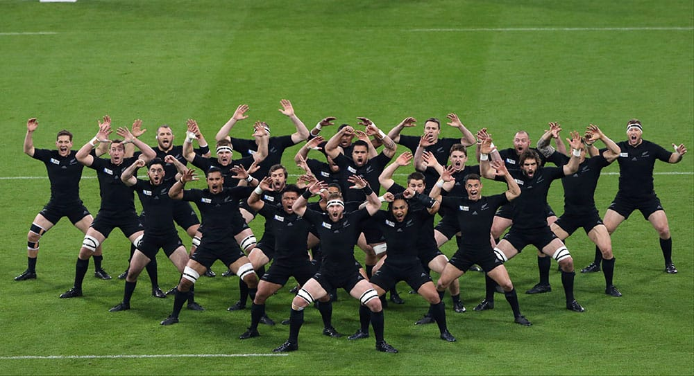 New Zealand players perform the haka before their Rugby World Cup Pool C match between New Zealand and Tonga at St James' Park, Newcastle, England.