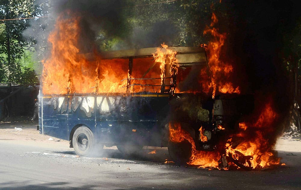 Irate mob burn a police vehicle in Gaya following a road accident.