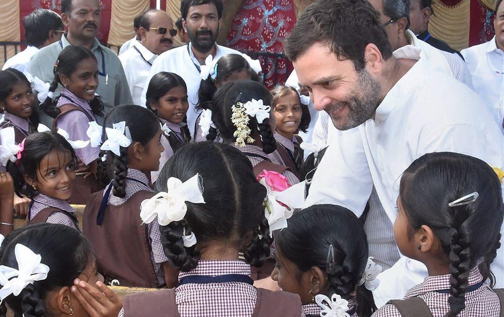 Congress Vice-President Rahul Gandhi interacts students at Maidur higher primary school during his padayatra from Maidur village in Haveri district of north Karnataka.