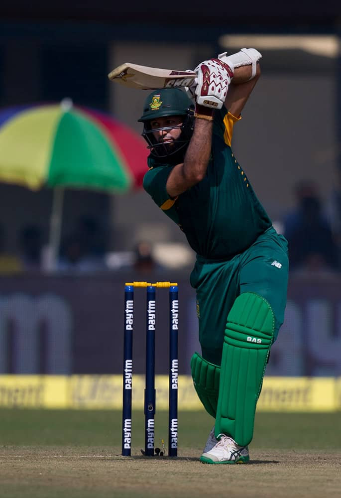 South African batsman Hashim Amla plays a shot while playing against India in the first of their five one-day match series in Kanpur, India.
