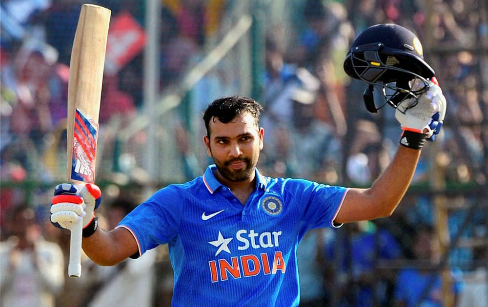 India's Rohit Sharma acknowledges the crowd after scoring hundred runs during the first one day international cricket match against South Africa in Kanpur, India.
