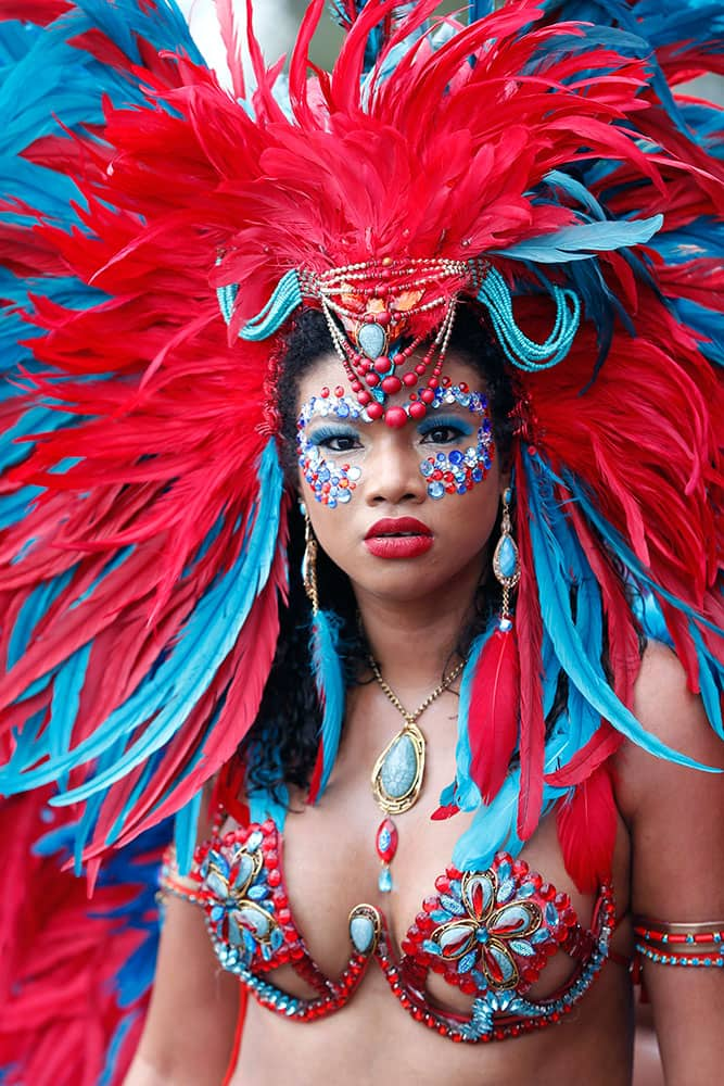 A Mas band dancer marches during a parade of bands as part of the Miami Broward Carnival.