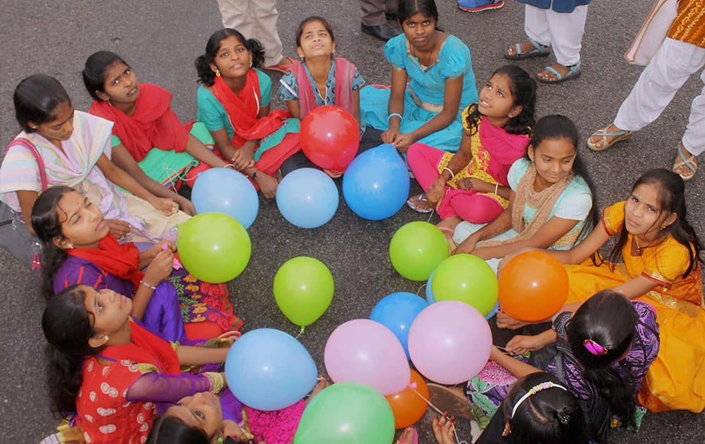 Girl children enjoy Raahgiri during the International Girl Child Day celebrations at Raahgiri in Telangana.
