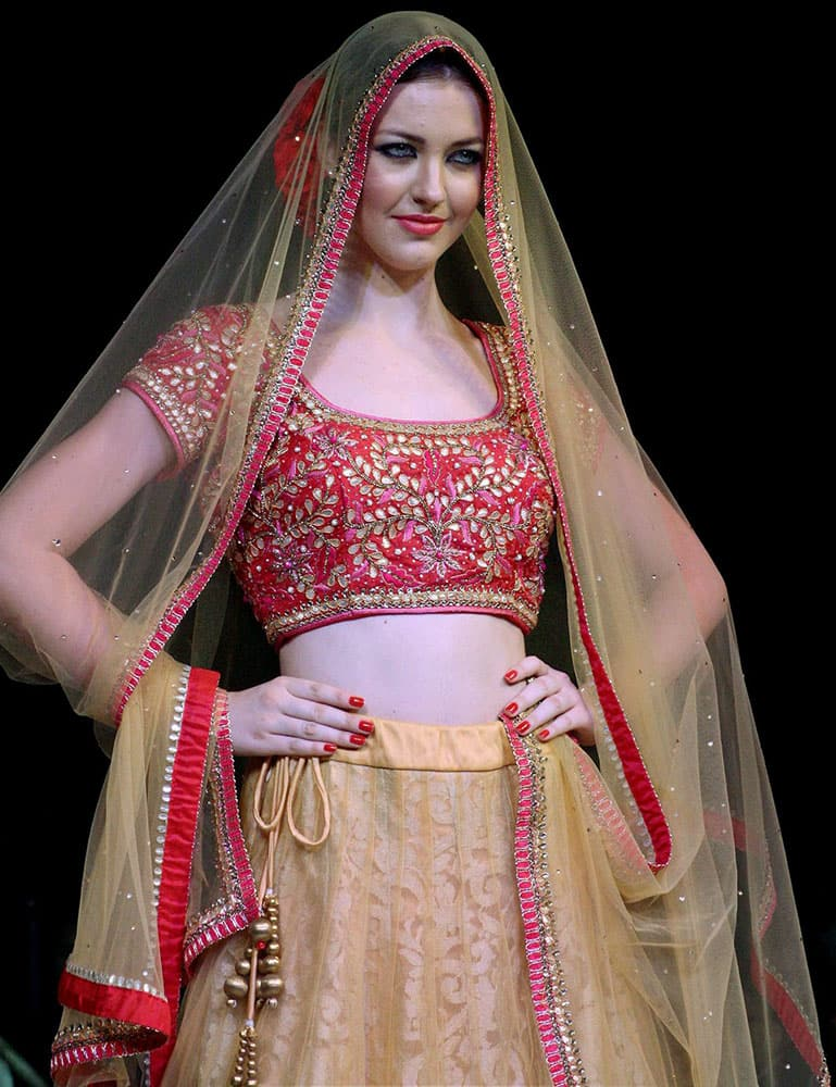 A model walks the ramp at a fashion show in Meerut.