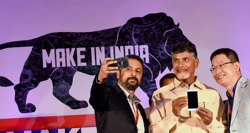 Andhra Pradesh Chief Minister N Chandrababu Naidu with Gionee group president, William Lu and Arvind R Vohra, CEO & Managing Director of Gionee India during the launch of Made in India Gionee smartphone manufactured at the Foxconn facility in Sri City at an event in Visakhapatnam.