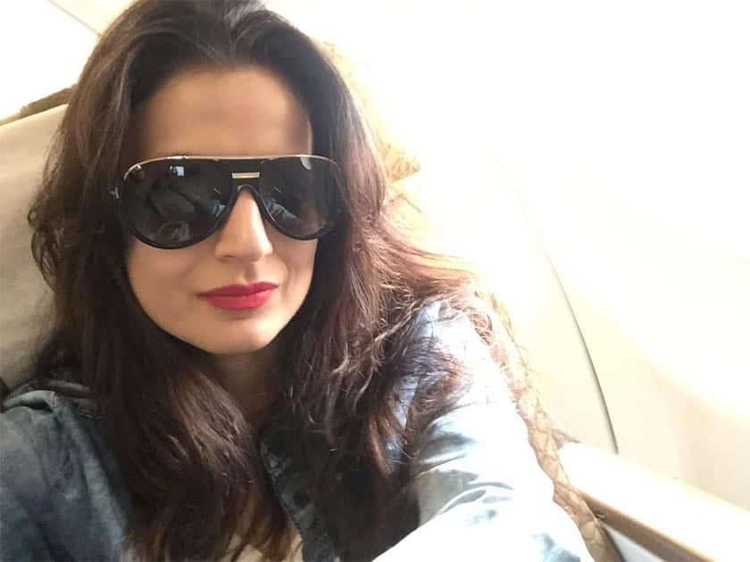 I'm on my way to banaras on air India.. A quik selfie on board before I take off . Twitter@ameesha_patel