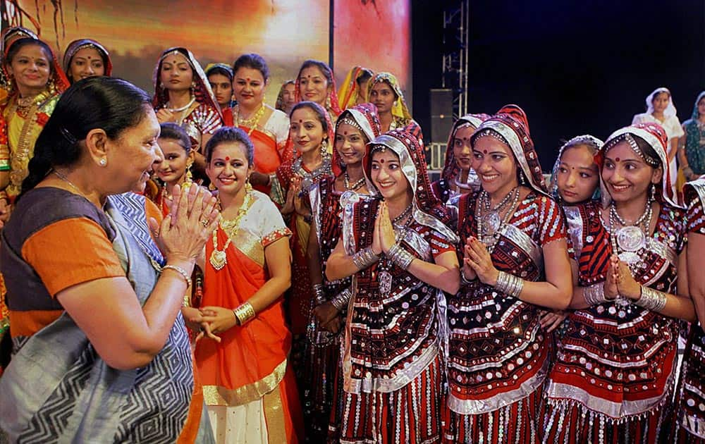 Gujarat Chief Minister Anandiben Patel with artists during the inauguration ceremony of Vibrant Navratri-2015, in Ahmedabad.