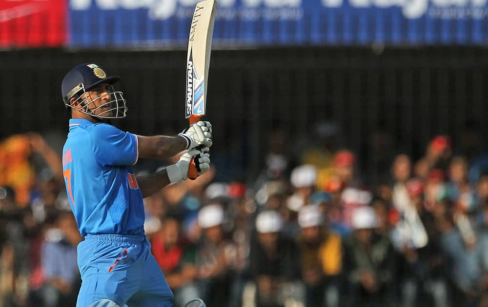MS Dhoni plays a shot during their second one day international cricket match against South Africa in Indore.