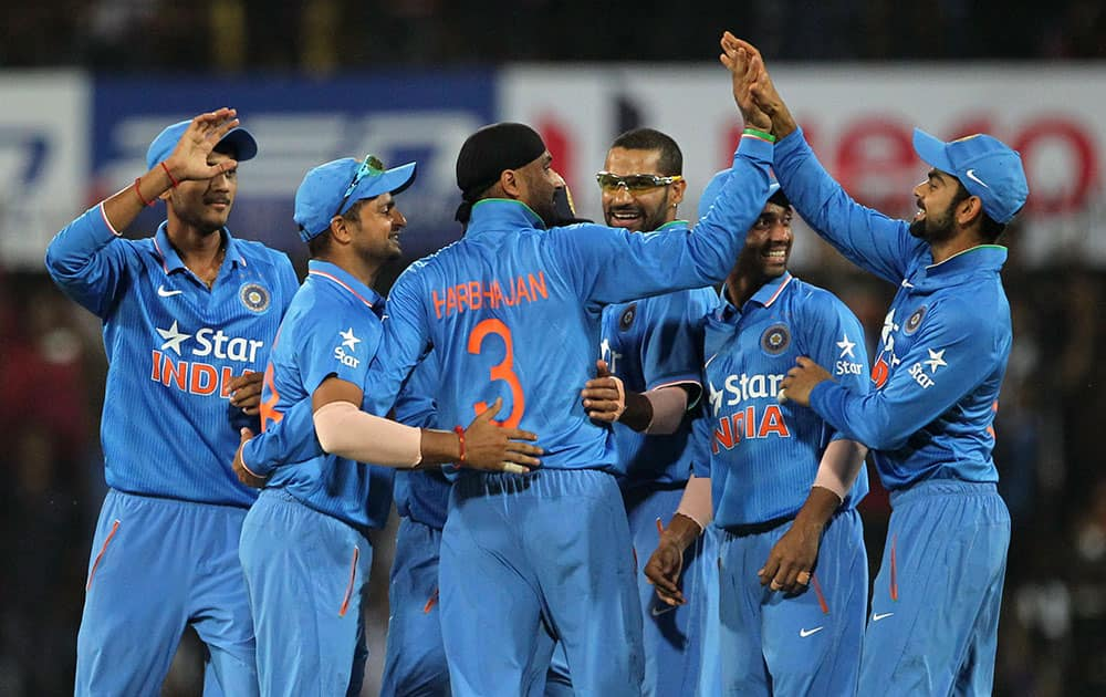 Indian players celebrate the wicket of South Africa's Quinton de Kock during their second one day international cricket match in Indore.