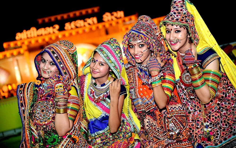 Artists attired in traditional dresses participate in Garba Festival Navratri-2015 in Ahmedabad.
