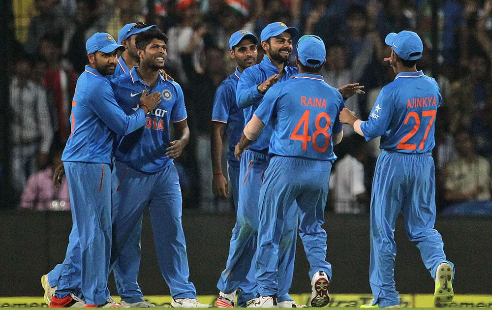 Indian players celebrate the dismissal of South Africa's Dale Steyn during their second one day international cricket match in Indore.