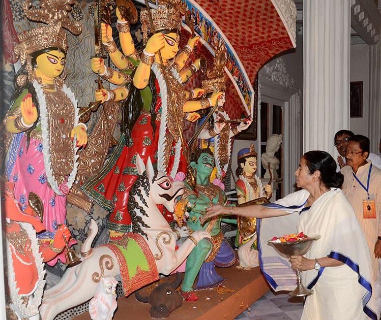 West Bengal Chief Minister Mamata Banerjee offers prayer during the inauguration of Goddess Durga puja pandal at Kumartully Sarvojanin.