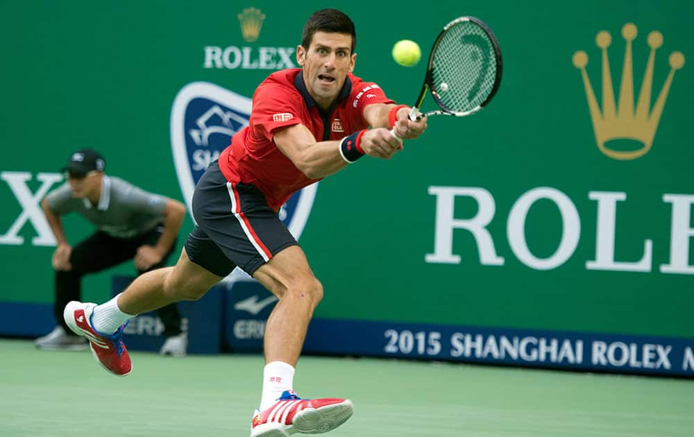Novak Djokovic of Serbia reaches for the ball as he plays against Feliciano Lopez of Spain during their Shanghai Masters tennis tournament in Shanghai, China.