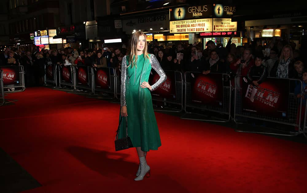 Agyness Deyn poses for photographers upon arrival at the premiere of the film 'Sunset Song', as part of the London film festival in London.
