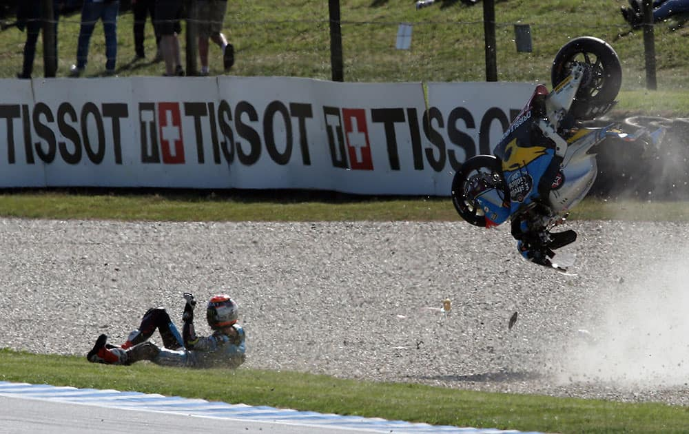 Moto2 rider Tito Rabat of Spain crashes on the exit to turn 11 during free practice two for the Australian Motorcycle Grand Prix at Phillip Island, Australia.