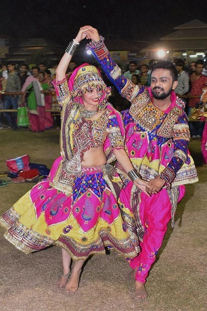 Artists perform garba during ongoing Navratri celebrations at Surat.