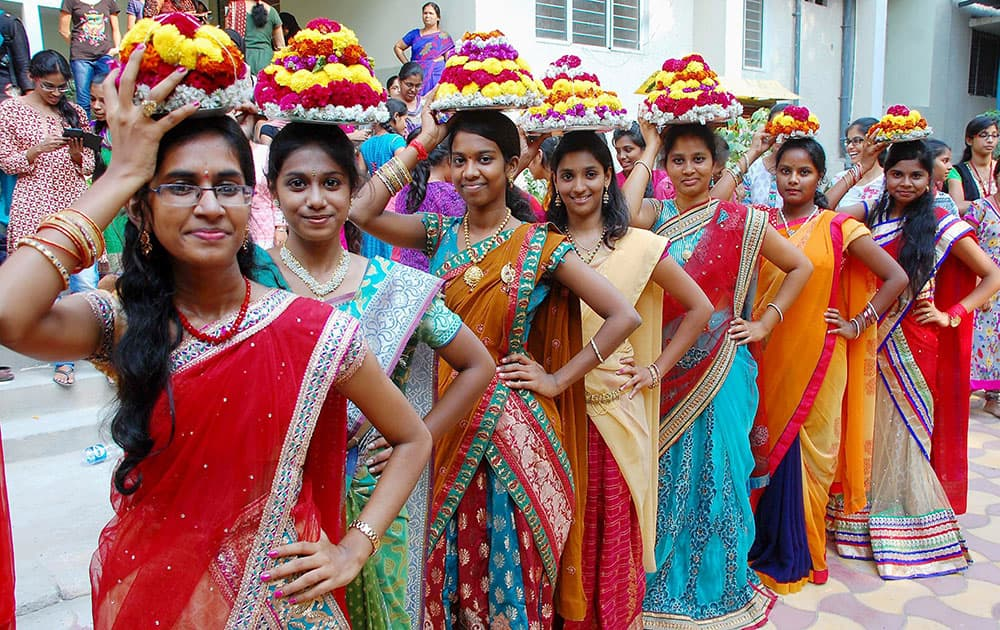Girls and women celebrating Badkamma festival at various places in Hyderabad.