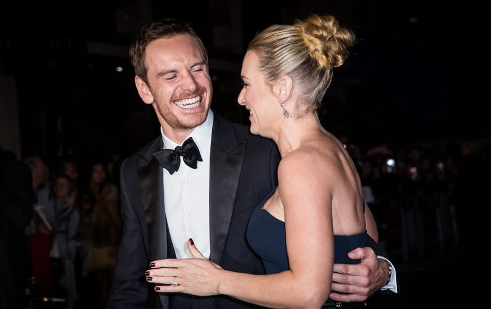 Michael Fassbender and Kate Winslet pose for photographers upon arrival at the premiere of the film Steve Jobs, as part of the London film festival in London.